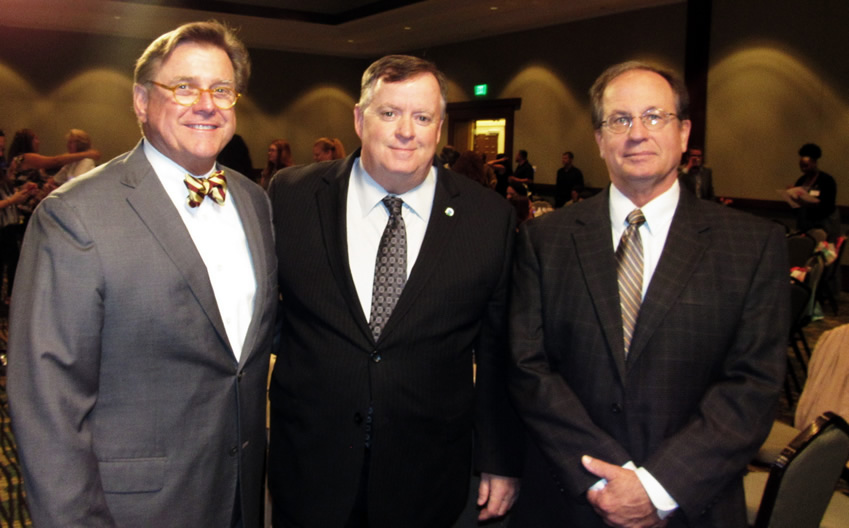 Douglas Sessions,CEO with DCF Secretary Mike Carroll and Advisory Board Chair Ted Granger